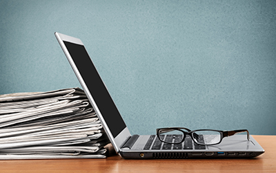 eubs-laptop-newspapers
